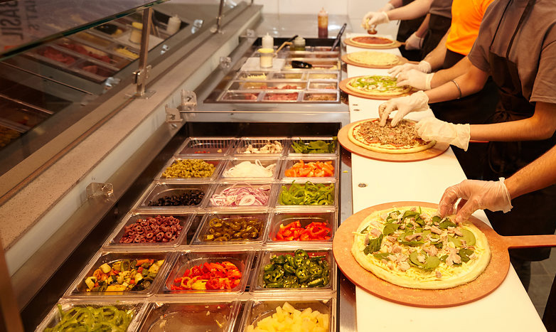 pizza counter line-up with fresh ingredients