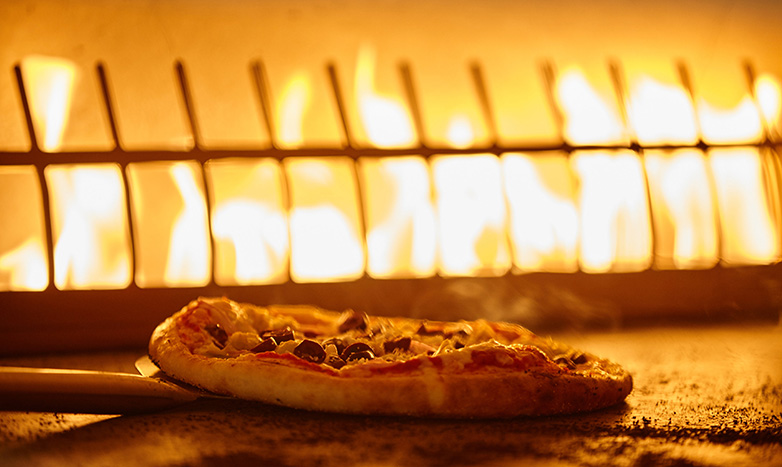 pizza in fire-deck oven